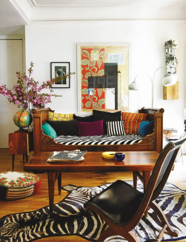 adorable-apartment-interior-design-with-black-leather-reclining-chair-and-zebra-printed-area-rug-and-wooden-table-and-sofa-and-colorful-cushions